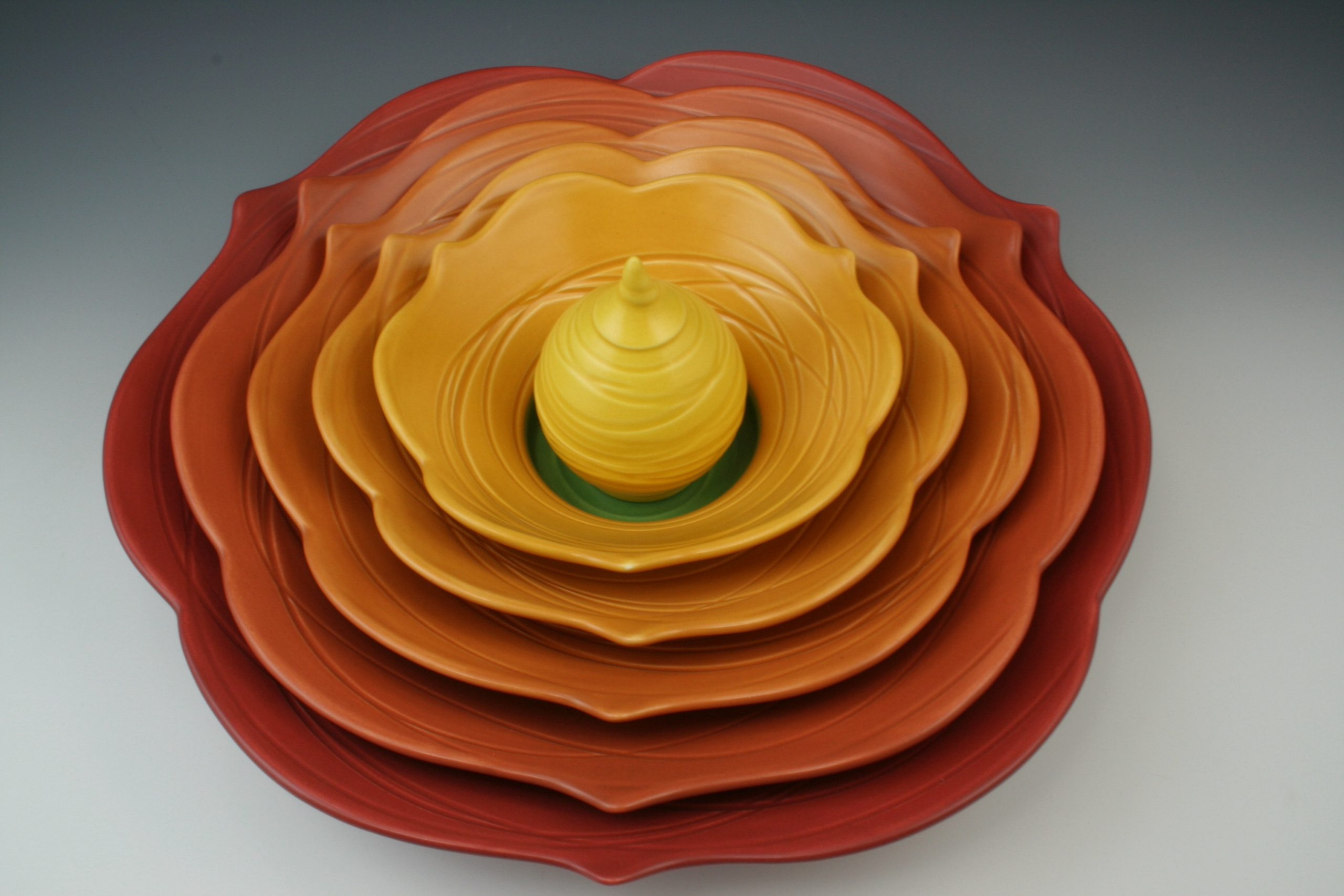 6 part thrown and altered orange and red functional ceramic centerpiece