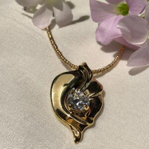 14K gold plated pendant holding a 1ct size Cubic Zirconia
